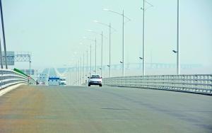 港珠澳大橋跨境車澳六百額  三地三檢收人民幣