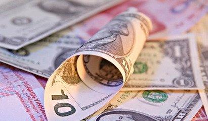 人民幣在跨境貿易結算中的成績與困境